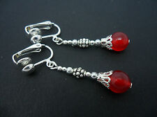 A PAIR OF DANGLY SILVER PLATED RED JADE BEAD  CLIP ON EARRINGS. NEW.