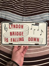 VINTAGE UNUSED LYNDON BRIDGE IS FALLING DOWN ANTI LBJ BOOSTER LICENSE PLATE TAG