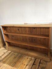 Wide low antique pine bookcase / shelves / shelving