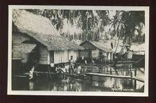 MALAY River Houses village policemen c1930s? RP PPC