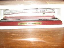A STATIC DIE-CAST MODEL OF THE HENSCHEL WEGMANN 4-6-4 CLASS TRAIN ON A PLINTH