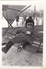 1970s Cute little girl with photo camera on swings winter Russian Soviet photo