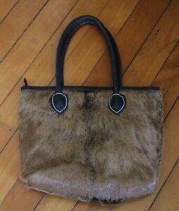 animal skin shoulder bag fur hair cow skin ? leather ?