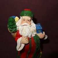"Santa Claus Figurine Holding Toy Bay Christmas Tree Hat 5"" Resin"
