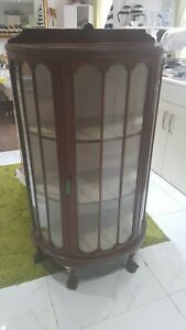 Antique Bow fronted glass cabinet with key