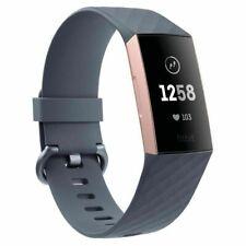 Fitbit Charge 3 Caja de Aluminio en Oro Rosa, Correa en Gris, Reloj Intelijente Unisexo