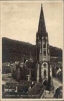 Freiburg im Breisgau  s/w AK 1925 Blick auf das Münster von Westen Straßenpartie