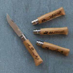 Opinel No. 8 pocket knife, game design, deer, dog, hare, goat, boar