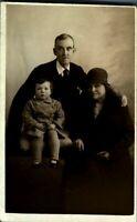Antique RPPC postcard real photograph portrait of an adorable family group