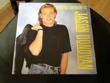 "Jason Donovan . Nothing Can Divide Us 7"" 45rpm Vinyl  CLASSIC HIT . 1988"