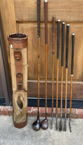 Antique hickory wood shaft golf Clubs and Canvas and Leather Stovepipe Bag