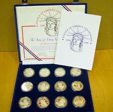 """11 x Medaille u. 1 US-Dollar 1986 Silber """"100 Jahre Freiheitsstatue"""" PP im Etui"""