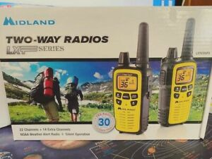 Midland Walkie-Talkie 36 channel 30 mile range.. Never been used ...yellow.