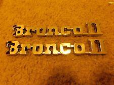 NOS NEW 1984 - 1990 FORD BRONCO II FRONT FENDER EMBLEMS CHROME PAIR E4TZ-16098-D
