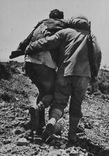 WWII photo US soldier leads a wounded man on his way to Okinawa war 25o