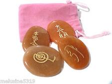 Lithothérapie  galets pierre massage soin aventurine symboles du reiki