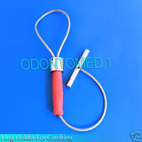 Hog Holder for Catching Red Grip Veterinary Instruments