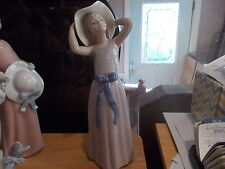 """Lladro Figurine #5011 """"Coy Girl"""" Girl Trying On Straw Hat Mint!"""