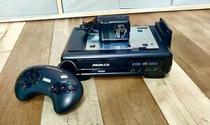 Sega Mega CD with Joy Pad Professionally Recapped, new fuse and Laser Cleaned