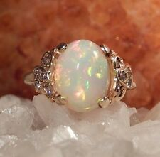 2.92 Ct Oval Opal And Diamond Ring In 14k Yellow Gold