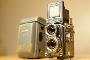 Yashica-44 with case. Guaranteed good working order.