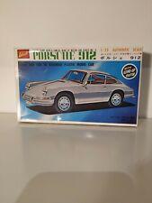 Discontinued Porsche 912 Tokyo Sharp TSM-6-150 Windup Assemble Model Car