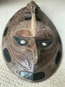 Highly carved and unique mask from the Sepik River region of Papua New Guinea