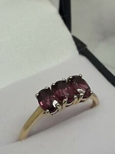 9ct yellow Gold 3 stone Amethyst Ring Size R 1/2 Weight 2.26 grams In New Box
