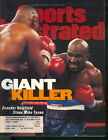 1996 Sports Illustrated: Evander Holyfield stuns Mike Tyson Heavyweight Champ