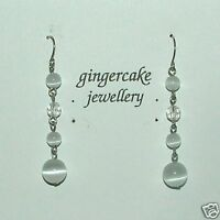 PRETTY WHITE GLASS BEAD AND SILVER PLATED DROP EARRINGS..... HOOK