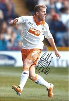 A 12 x 8 inch photo, signed by Billy Clarke when at Blackpool
