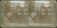 Scottish troops examine fragments of shell in craters - WW1 Stereoview