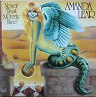 "Vinyle 33T Amanda Lear ""Never trust a pretty face"" + poster"