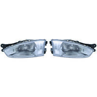 Fits 1997-2002 Mitsubishi Mirage Pair Head Lights Driver and RH Coupe