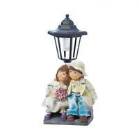 Summerfield Terrace - Couple With Solar Street Light Statue