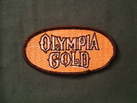 """OLYMPIA GOLD BEER SEW ON PATCH UNUSED ORIGINAL 2"""" X 4"""" OVAL"""