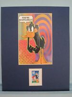 Saluting Daffy Duck with his own stamp