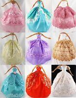 30 items=Barbie Dresses/Clothes/grows & hangers & shoes