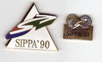 Pinsfolies Lot de 2 pin's Sippa Salon international 90 et 91