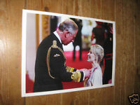 Kylie Minogue Receiving OBE From Prince Charles POSTER