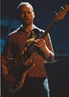 FOO FIGHTERS: NATE MENDEL SIGNED 7x5 ACTION PHOTO+COA