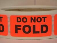 DO NOT FOLD Warning Sticker Label on a red/orange fluorescent  500/rl