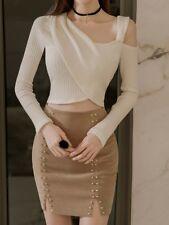 Élégant conjunto de mujer suéter blanco mini falda beige mangas ceñido 3217