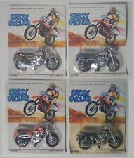 Set of  4 Vintage Kawasaki & Triumph Motorcycles