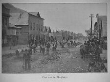 PHOTOGRAVURE UNE RUE DE SKAGWAY EN CONSTRUCTION CANADA ANNÉE 1898