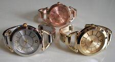 Women's designer look assorted finish bangle cuff fashion casual/dressy watch