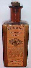 Scarce amber PORTLAND OREGON embossed drug store bottle w/ COOPER'S Cure label