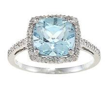 10k White Gold Cushion Blue Topaz and Diamond Ring (1/4 TDW)