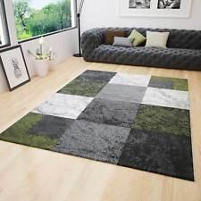 Alfombra jaspeada motivo cuadrados contorno cortado a mano en verde crema y gris
