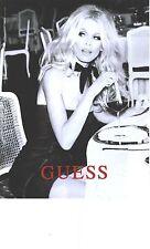 PUBLICITE 2012   GUESS haute couture CLAUDIA SCHIFFER en dégustation de ????